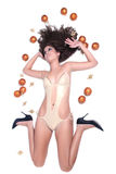 Attractive sexy woman with shine gold bikini lying, Christmas balls around her Royalty Free Stock Image