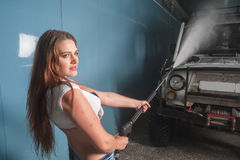 Attractive sexy woman washing car Stock Images