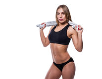 Attractive sexy woman after workout with towel isolated over white background. Young female with muscular body. Royalty Free Stock Photography