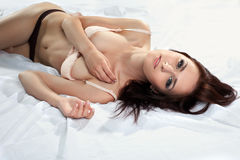 Attractive sexy young girl on silk undress bra Royalty Free Stock Image