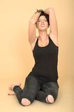 Attractive Sexy Young Woman Wearing Black Jeans and Vest Top Royalty Free Stock Photography