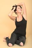 Attractive Sexy Young Woman Wearing Black Jeans and Vest Top Stock Photos