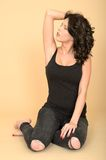 Attractive Sexy Young Woman Wearing Black Jeans and Vest Top Stock Photo