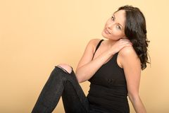 Attractive Sexy Young Woman Wearing Black Jeans and Vest Top Royalty Free Stock Image