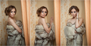 Attractive sexy young woman wearing a fur coat posing provocatively indoor. Portrait of sensual female with creative haircut Royalty Free Stock Photography