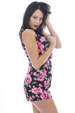 Attractive Sexy Young Woman Wearing a Short Floral Playsuit Stock Photo