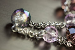 Attractive shiny purple beads on jewellery Royalty Free Stock Photography