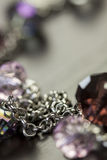 Attractive shiny purple beads on jewellery Royalty Free Stock Image