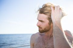 Handsome man on beach Stock Photo