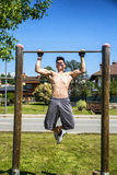 Attractive shirtless young man exercising outdoor Stock Photography