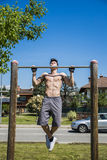 Attractive shirtless young man exercising outdoor Royalty Free Stock Photos