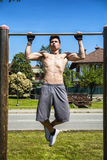 Attractive shirtless young man exercising outdoor Stock Images