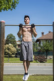 Attractive shirtless young man exercising outdoor Royalty Free Stock Photo