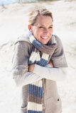 Attractive shivering blonde standing on the beach Stock Images