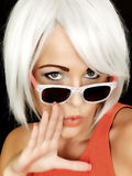 Attractive Shocked Young Woman Wearing Sunglasses Stock Photography