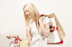 Attractive shopper returning from a mall Royalty Free Stock Photos