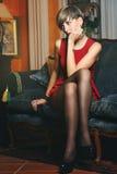 Attractive short hair model on a velvet sofa Stock Images