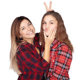 Attractive sisters goofing around and smiling. At the camera. White background royalty free stock photography