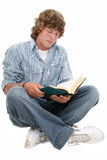 Attractive Sixteen Year Old Teen Boy Reading Book Stock Images