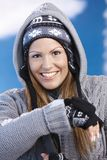 Attractive skier taking a break on top Royalty Free Stock Photography