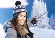 Attractive skier taking a break on top smiling Stock Images