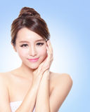 Attractive Skin care woman face. Close up of attractive Skin care woman face with blue background, asian Stock Images