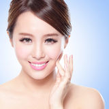 Attractive Skin care woman face. Close up of attractive Skin care woman face with blue background, asian Royalty Free Stock Photo