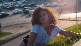 Attractive skinny mulatto woman lying on the grass and acting sexy stock video