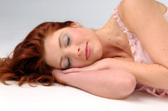 The attractive sleeping redhead women Stock Images