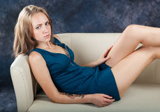 Attractive slender girl on divan Stock Photo