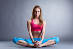 Attractive slim athlete sitting in lotus position Stock Images