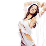 Attractive slim brunette in white sexy outfit. Royalty Free Stock Photo