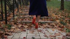 Lady in orange high heel shoes walking upstairs stock video footage