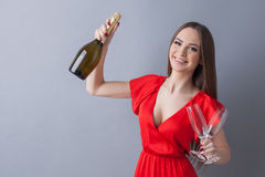 Attractive slim girl is celebrating the event Stock Photography