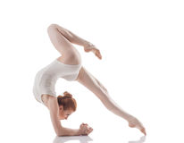 Attractive slim girl doing acrobatic trick Royalty Free Stock Images