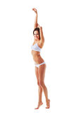 Attractive slim sporty woman with hands up Stock Image