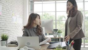 Free Attractive Smart Asian Business Woman In Smart Casual Wear Working On Laptop While Sitting On Desk While Her Angry Manager. Stock Photos - 127949953
