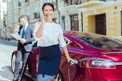 Attractive smart businesswoman having a phone conversation Royalty Free Stock Images
