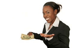 Attractive, smartly dressed african-american woman smiling and s. Howing money and indicating that is easy to be successful Stock Images