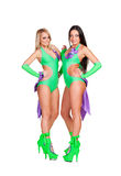 Attractive and smiley go-go dancers. Two attractive and smiley go-go dancers in stage costume posing over white background Royalty Free Stock Photo
