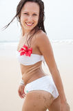 Attractive smiley woman on the beach Royalty Free Stock Images