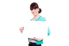 Attractive smiley woman holding empty blank Royalty Free Stock Images