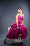 Attractive smiley woman in pink dress Stock Images