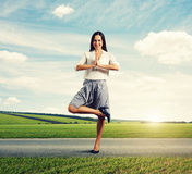 Attractive smiley woman in yoga pose Stock Image
