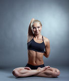 Attractive smiling blonde posing in asana. Image of attractive smiling blonde posing in asana Stock Photo