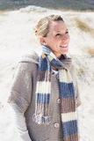 Attractive smiling blonde standing on the beach Stock Photos