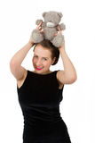 Attractive smiling brunette holding teddy bear Royalty Free Stock Photos