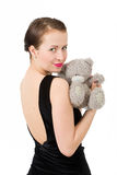 Attractive smiling brunette holding teddy bear Stock Image
