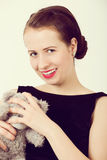 Attractive smiling brunette holding teddy bear Stock Photo