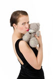 Attractive smiling brunette holding teddy bear Royalty Free Stock Images